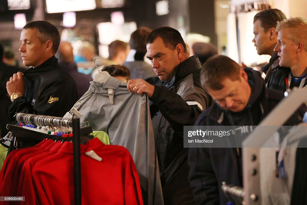 Fans look at merchandise in the club store prior to the Barclays Premier League match between Newcastle United and Crystal Palace at St James' Park on April 30, 2016 in Newcastle upon Tyne, England.