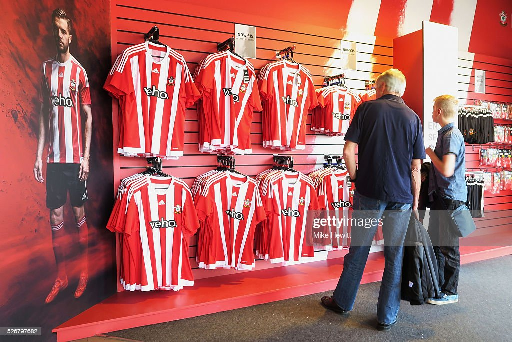 Fans look at merchandise in the club store prior to the Barclays Premier League match between Southampton and Manchester City at St Mary's Stadium on May 1, 2016 in Southampton, England.