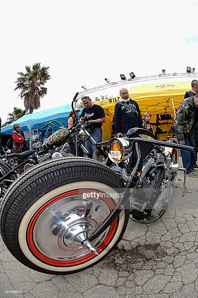 Fans look at motorbikes parked after a parade during the 2010 Harley-Davidson Euro Festival in Grimaud, near Saint-Tropez, southeastern France, which gather thousands of US legendary bikes on May 8, 2010. The event is scheduled from May 6 to 9.