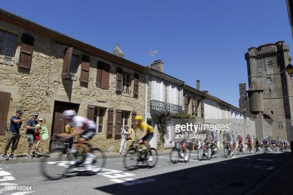 Fans look at Overall leader's yellow jersey British Bradley Wiggins riding in a village during the 191 km and fourteenth stage of the 2012 Tour de...