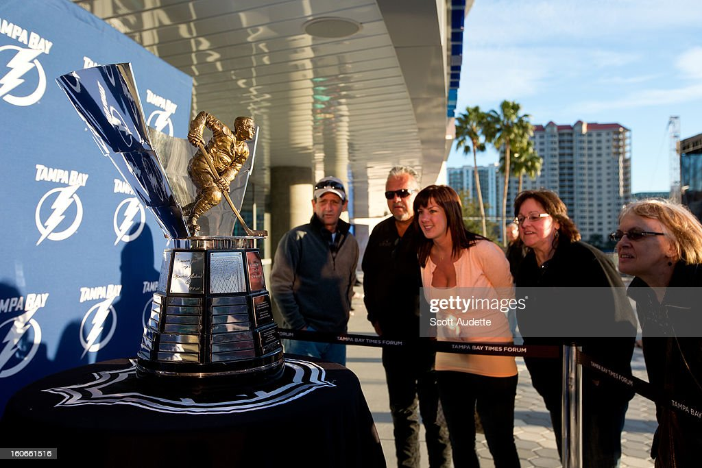 Fans look at the Maurice 'Rocket' Richard Trophy on February 1, 2013 in Tampa, Florida. The trophy was awarded to Steven Stamkos #91 of the Tampa Bay Lightning for the 2011-12 season.
