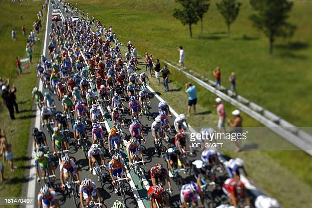 Fans look at the pack ridding on the roadside on July 4 2010 in the 2035 km and first stage of the 2010 Tour de France cycling race run between...