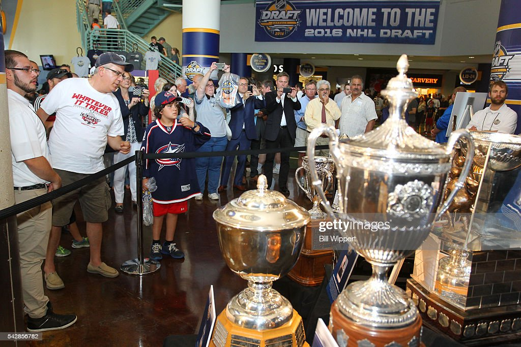 Fans look at the trophies display prior to the 2016 NHL Draft at First Niagara Center on June 24, 2016 in Buffalo, New York.