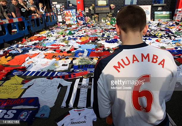 Fans look at tributes for Fabrice Muamba are seen outside the stadium ahead of the Barclays Premier League match between Bolton Wanderers and...