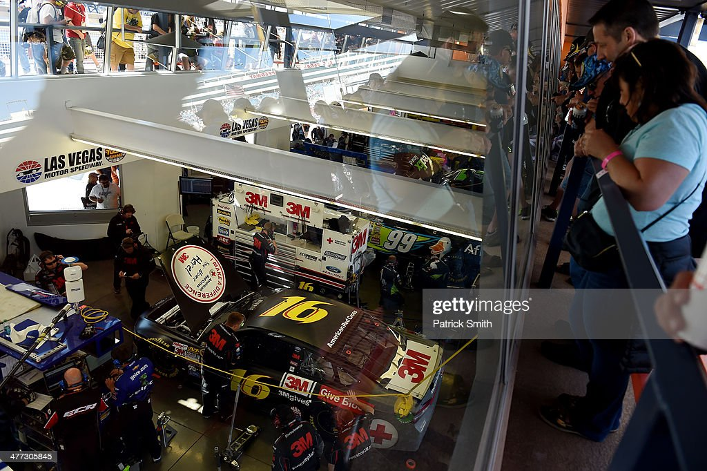 Fans look into the garage area during practice for the NASCAR Sprint Cup Series Kobalt 400 at Las Vegas Motor Speedway on March 8, 2014 in Las Vegas, Nevada.