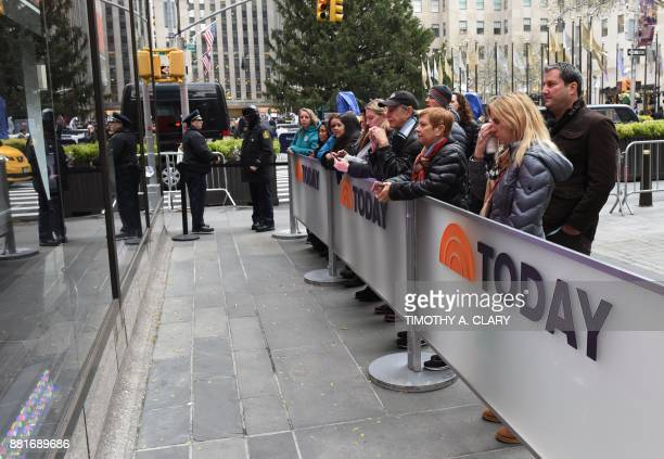Fans look into the windows at the end of the morning Today show segment on November 29 2017 after it was announced Matt Lauer was terminated by NBC...