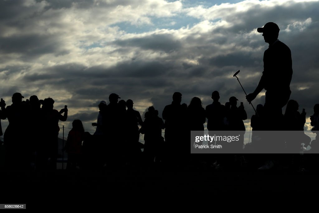 Fans look on as Jordan Spieth of the United States walks up the 16th fairway during Saturday afternoon four-ball matches of the Presidents Cup at Liberty National Golf Club on September 30, 2017 in Jersey City, New Jersey.
