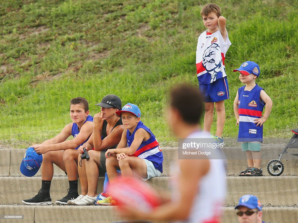 Fans look on as Luke Dahlhaus of the Bulldogs lines up for goal during the Western Bulldogs AFL intra-club match at Whitten Oval on February 13, 2016 in Melbourne, Australia.