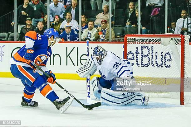 Fans look on as New York Islanders Center John Tavares attempts break away shot against Toronto Maple Leafs Goalie Jhonas Enroth during the Toronto...
