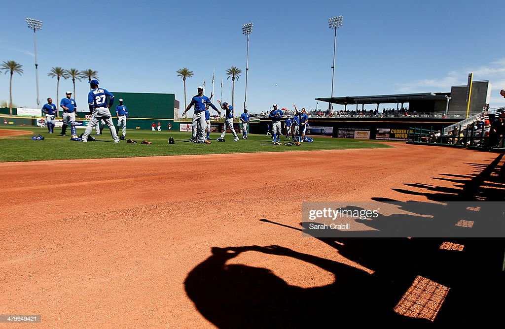 Fans look on before a game between the Cincinnati Reds and the Kansas City Royals at Goodyear Ballpark on March 21 2014 in Goodyear Arizona