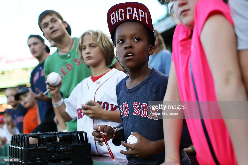 Fans look on before the game between the Tampa Bay Rays and the Boston Red Sox at Fenway Park on August 29 2016 in Boston Massachusetts