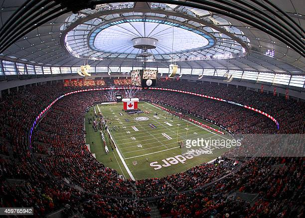 52056 fans look on during the Canadian national anthem at the start of the 102nd Grey Cup Championship Game between the Hamilton TigerCats and the...