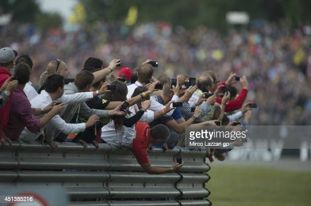 Fans look on during the MotoGP race during the MotoGP of Netherlands Race at on June 28 2014 in Assen Netherlands