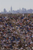 Fans look on during the US Open at the USTA National Tennis Center in Flushing Meadows Corona Park on September 10 2005 in the Flushing neighborhood...