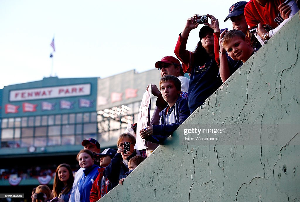 Fans look on during the World Series victory parade at Fenway Park on November 2, 2013 in Boston, Massachusetts.