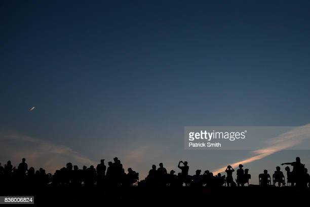 Fans look on from a hill side outside of the stadium as the Pittsburgh Pirates play the St Louis Cardinals in the inaugural MLB Little League Classic...