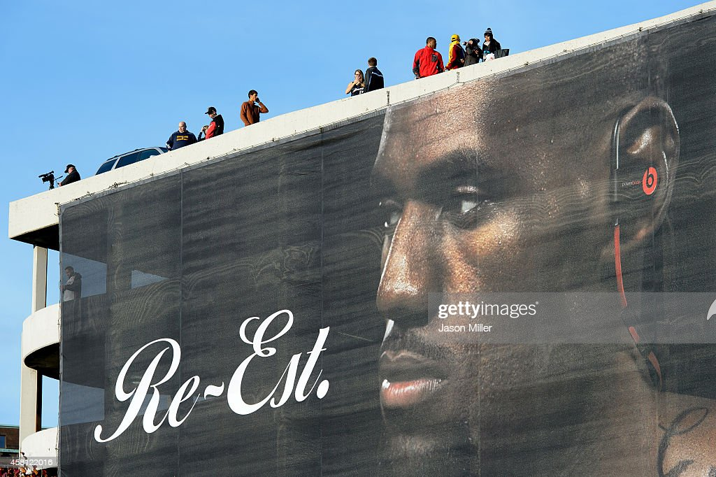 Fans look on from above a LeBron James banner outside Quicken Loans Arena before a game between the Cleveland Cavaliers and the New York Knicks on October 30, 2014 in Cleveland, Ohio.
