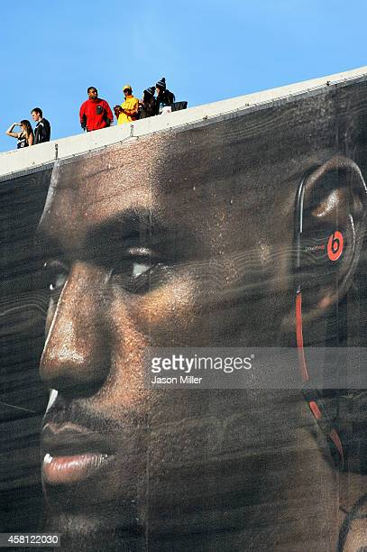 Fans look on from above a LeBron James banner outside Quicken Loans Arena before a game between the Cleveland Cavaliers and the New York Knicks on...