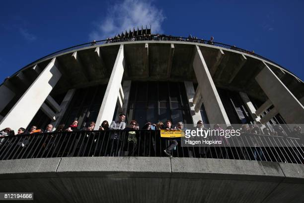 Fans look on from the Beehive during the Team New Zealand Americas Cup Wellington Welcome Home Parade on July 11 2017 in Wellington New Zealand