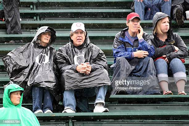 Fans look on from the stands in the rain during Day One of the 2012 US Olympic Track Field Team Trials at Hayward Field on June 22 2012 in Eugene...