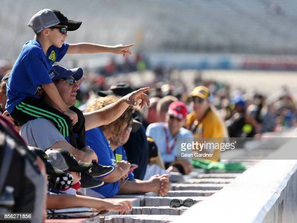 Fans look on prior to the Monster Energy NASCAR Cup Series Apache Warrior 400 presented by Lucas Oil at Dover International Speedway on October 1...