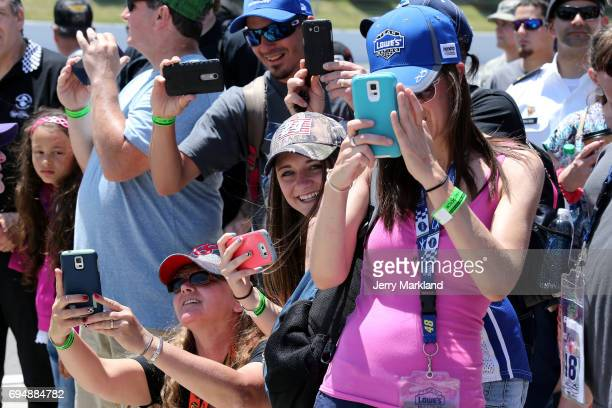 Fans look on prior to the Monster Energy NASCAR Cup Series Axalta presents the Pocono 400 at Pocono Raceway on June 11 2017 in Long Pond Pennsylvania