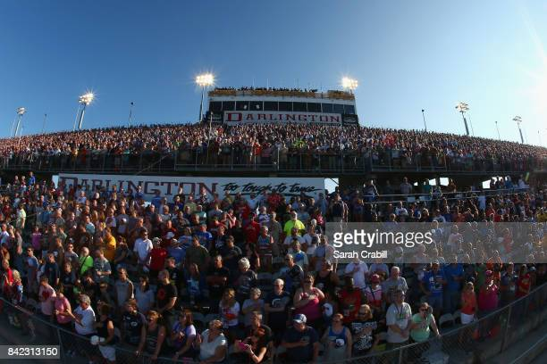 Fans look on prior to the start of the Monster Energy NASCAR Cup Series Bojangles' Southern 500 at Darlington Raceway on September 3 2017 in...
