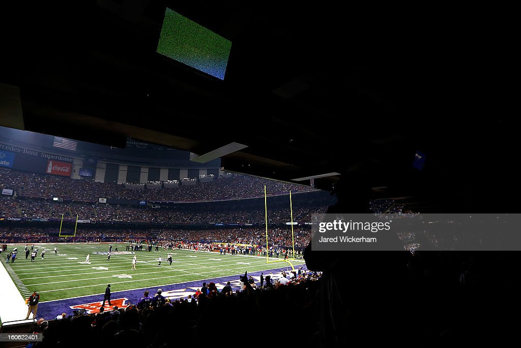 Fans look on to the field after a sudden power outage in the second quarter during Super Bowl XLVII at the Mercedes-Benz Superdome on February 3, 2013 in New Orleans, Louisiana.