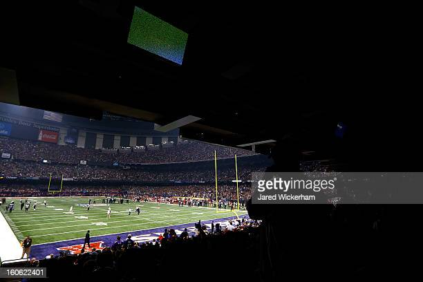 Fans look on to the field after a sudden power outage in the second quarter during Super Bowl XLVII at the MercedesBenz Superdome on February 3 2013...