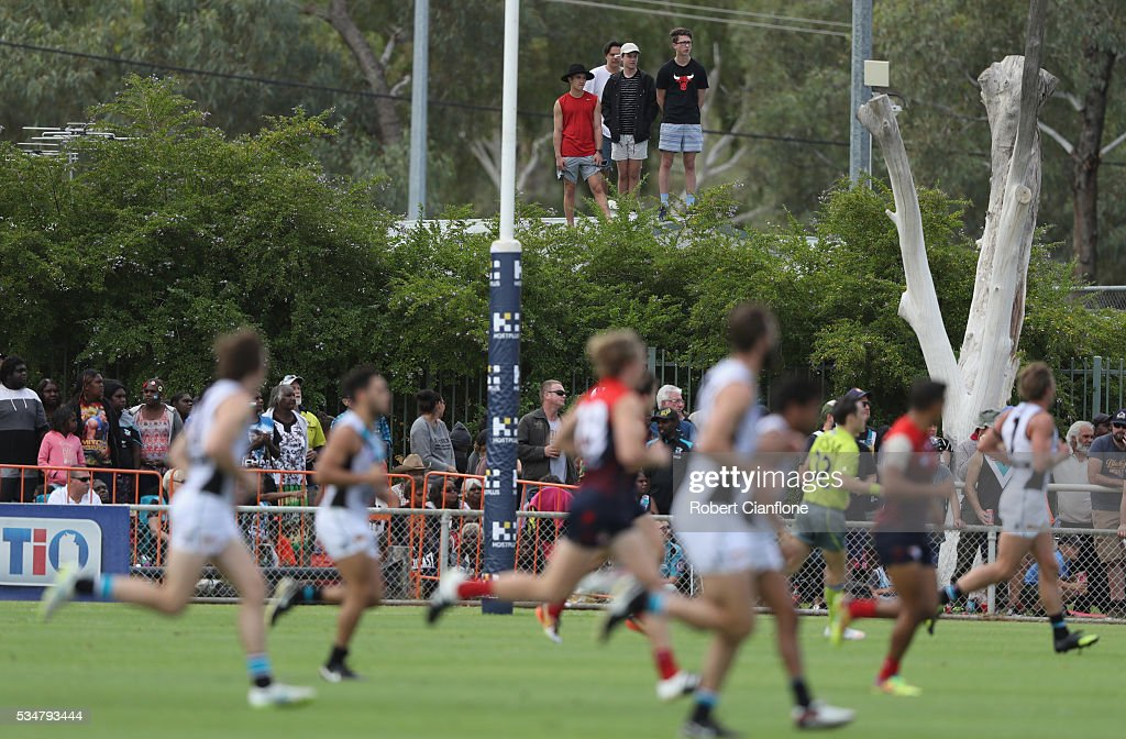 Fans look to get a vantage point of the match during the round 10 AFL match between the Melbourne Demons and the Port Adelaide Power at Traeger Park on May 28, 2016 in Alice Springs, Australia.