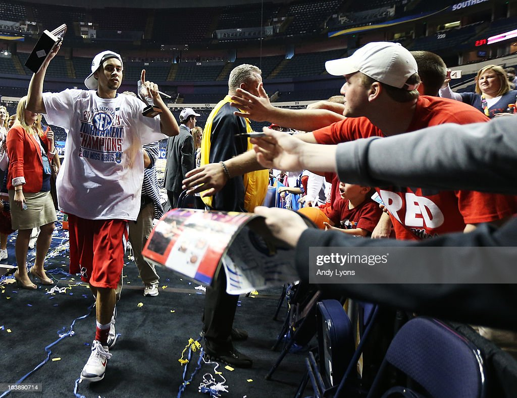 Fans look to Marshall Henderson #22 of the Ole Miss Rebels as he celebrates their 66 to 63 win over the Florida Gators in the SEC Basketball Tournament Championship game at Bridgestone Arena on March 17, 2013 in Nashville, Tennessee.