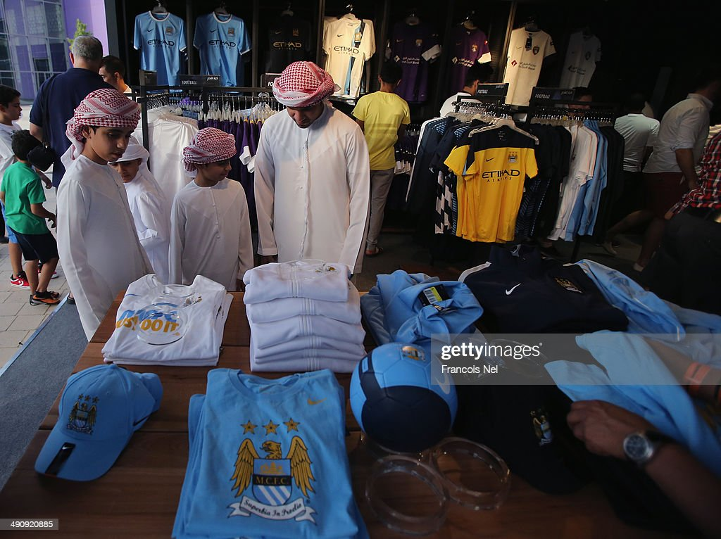 Fans looks at Manchester City jerseys on display prior to the friendly match between Al Ain and Manchester City at Hazza bin Zayed Stadium on May 15, 2014 in Al Ain, United Arab Emirates.
