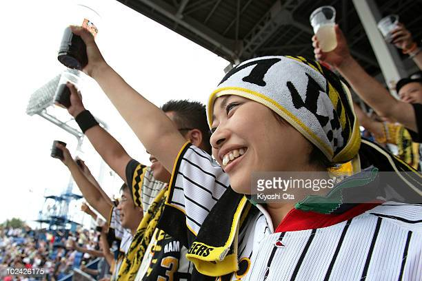 Fans make a simultaneous toast raising their cups in the Guinness World Record attempt for the largest toast during the fifth inning of the baseball...