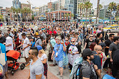 Fans make their way across Harbor Blvd to ComicCon International Day 3 on July 22 2016 in San Diego California