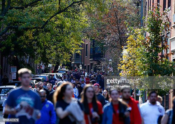 Fans make their way down side streets in the Back Bay section of Boston during the World Series victory parade on November 2 2013 in Boston...