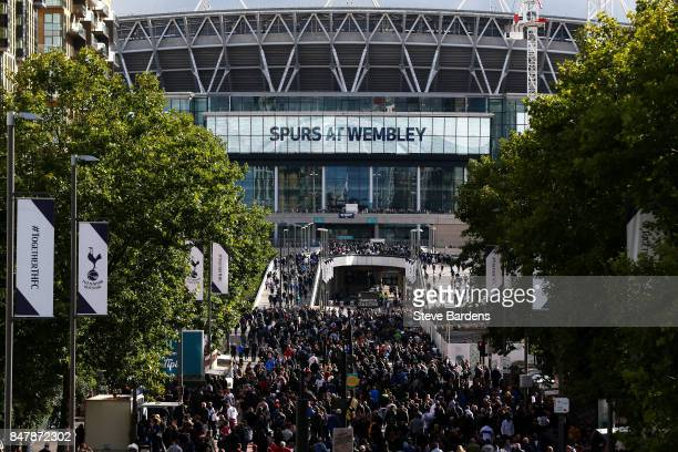 Fans make their way to stadium prior to the Premier League match between Tottenham Hotspur and Swansea City at Wembley Stadium on September 16 2017...