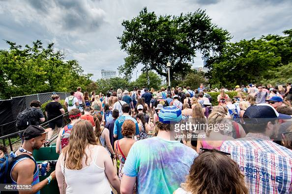 Fans make their way to the exits following an evacuation order as storms approach the Lollapalooza festival grounds at Grant Park on August 2 2015 in...