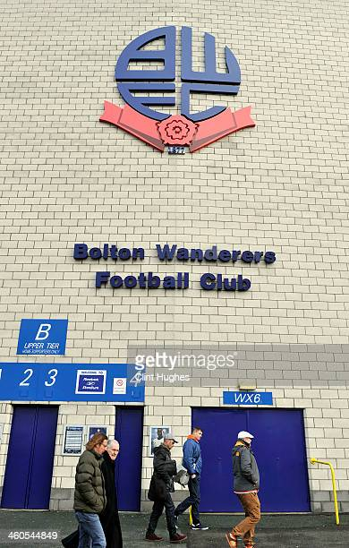 Fans make their way to the ground for the Budweiser FA Cup Third Round match between Bolton Wanderers and Blackpool at the Reebok Stadium on January...
