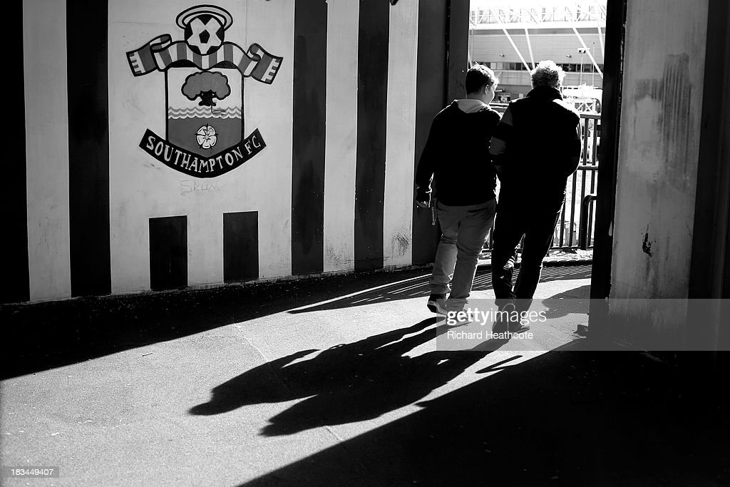 Fans make their way to the ground prior to the Barclays Premier League match between Southampton and Swansea City at St Mary's Stadium on October 6, 2013 in Southampton, England.