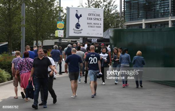 Fans make their way to the official Tottenham Hotspur fan space before the Premier League match between Tottenham Hotspur and Chelsea at Wembley...