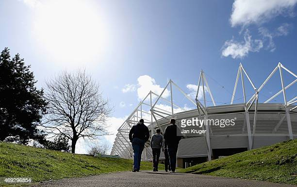 Fans make their way to the stadium ahead of the Barclays Premier League match between Swansea City and Everton at Liberty Stadium on April 11 2015 in...