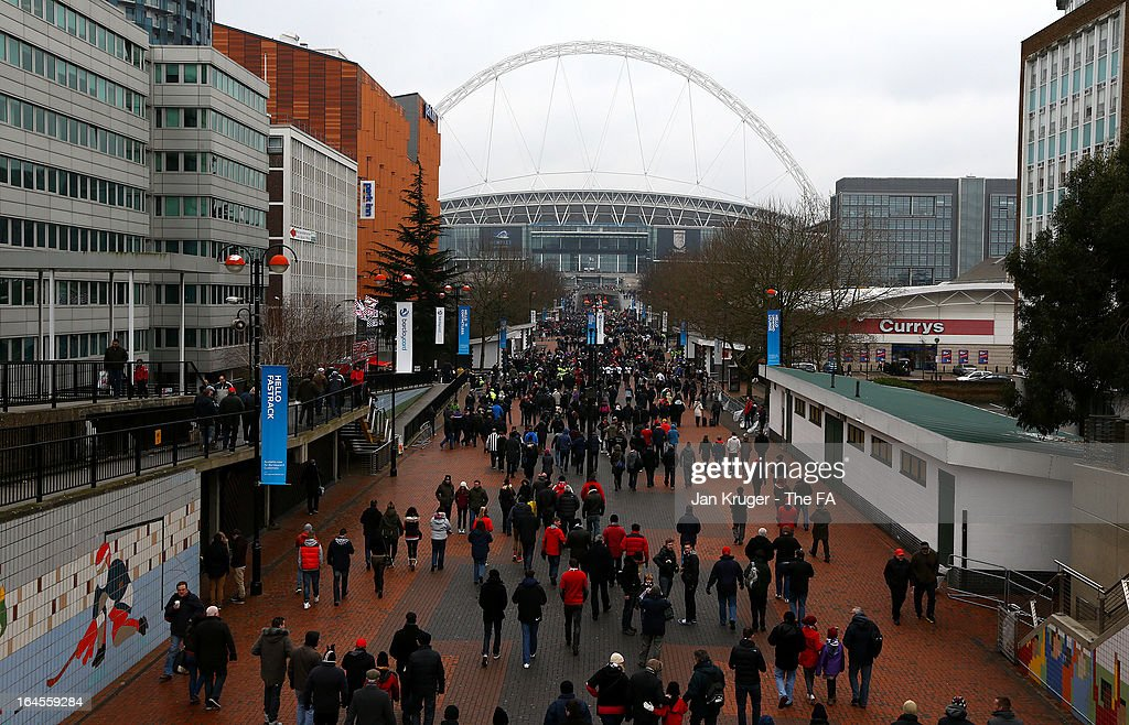 Fans make their way to the stadium ahead of the FA Trophy Final between Wrexham and Grimsby Town at Wembley Stadium on March 24, 2013 in London, England.