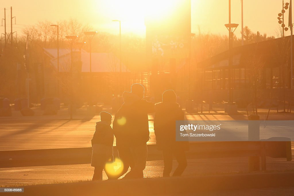 Fans make their way to the stadium at sunrise before the start of the Buffalo Bills NFL game against the Houston Texans at Ralph Wilson Stadium on...
