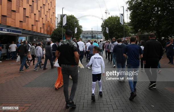 Fans make their way to the stadium before the Premier League match between Tottenham Hotspur and Chelsea at Wembley Stadium on August 20 2017 in...