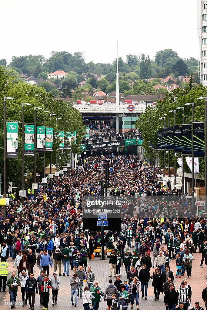 Fans make their way to the stadium down Wembley Way ahead of the Sky Bet League Two Play Off Final match between Plymouth Argyle and AFC Wimbledon at Wembley Stadium on May 30, 2016 in London, England.