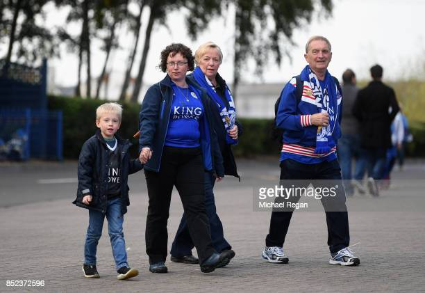Fans make their way to the stadium during the Premier League match between Leicester City and Liverpool at The King Power Stadium on September 23...