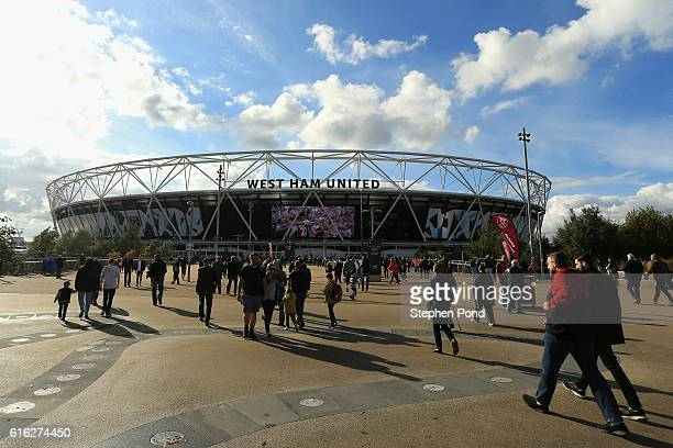 Fans make their way to the stadium prior to kick off during the Premier League match between West Ham United and Sunderland at Olympic Stadium on...