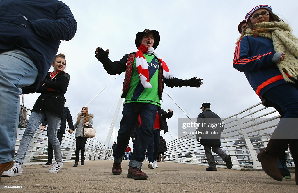 Fans make their way to the stadium prior to the Barclays Premier League match between Swansea City and Southampton at Liberty Stadium on February 13, 2016 in Swansea, Wales.