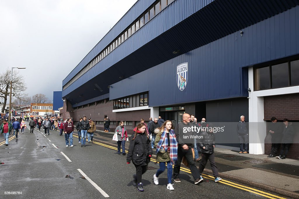 Fans make their way to the stadium prior to the Barclays Premier League match between West Bromwich Albion and West Ham United at The Hawthorns on April 30, 2016 in West Bromwich, England.