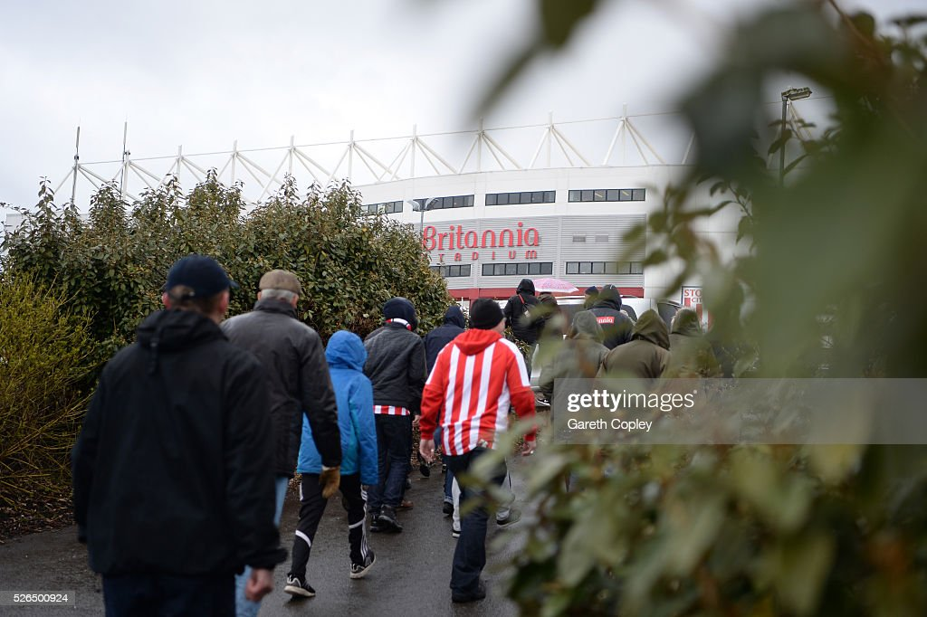 Fans make their way to the stadium prior to the Barclays Premier League match between Stoke City and Sunderland at the Britannia Stadium on April 30, 2016 in Stoke on Trent, England.